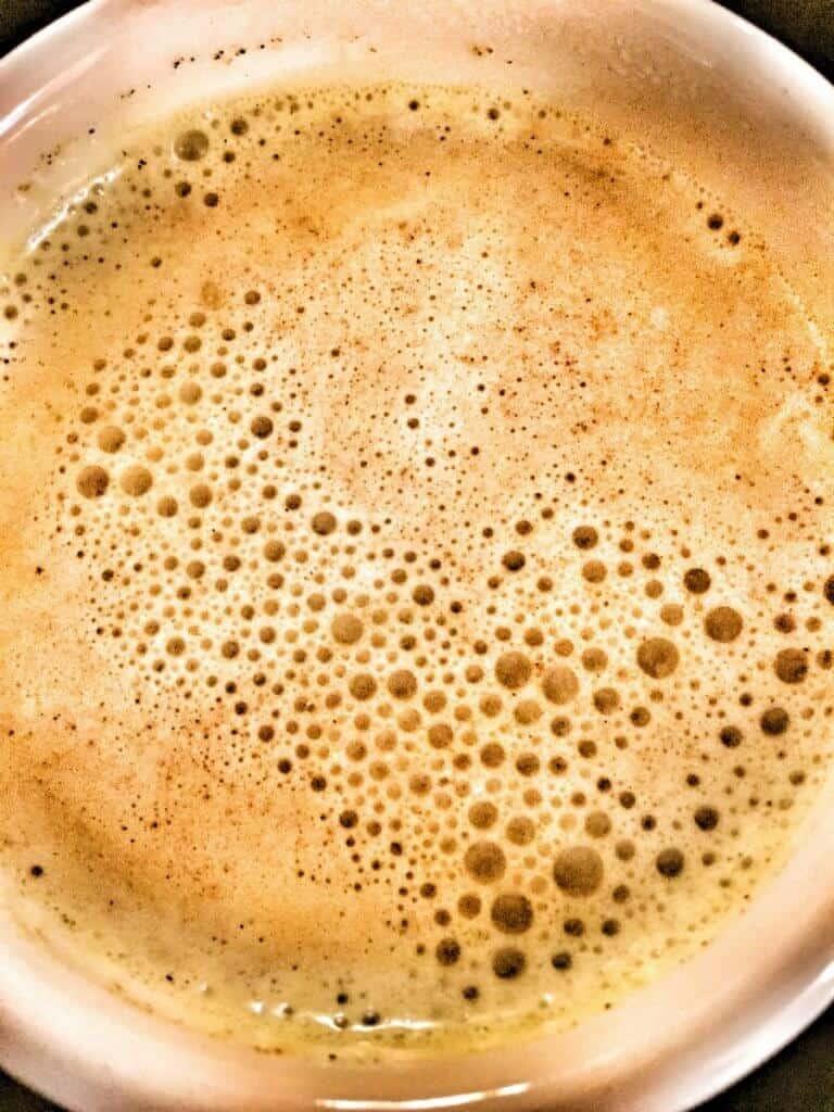 Golden milk tea in cup.