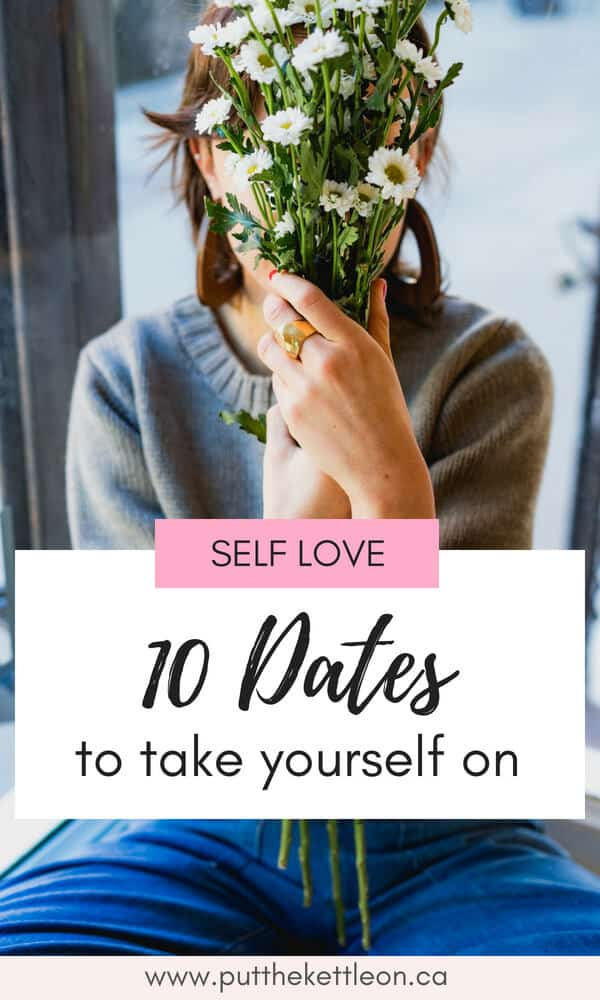 Woman holding white flowers in front of her face. Includes text overlay: Self Love. 10 Dates to take yourself on.