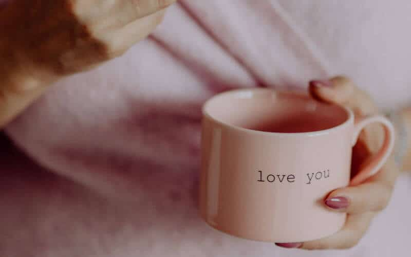 "Pink mug that says ""love you"""